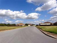 LARGE CORNER LOT This well maintained gated community