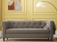 This modern chesterfield style tufted sofa is in great