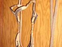 Slightly used western bridle with rawhide pieces on the