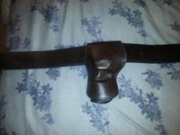 Western style weapon belt and holster. Holster is made