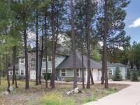 WESTWOOD ESTATES CUSTOM HOME ON 2 TREED ACRES WITH