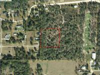 2.57 oak shaded acres on a cul-de-sac with public water