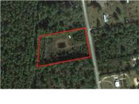 3 acres with a pond, partially fenced with a well and