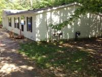 Nice 3 bedroom, 2 bath home tucked into the woods on a