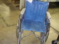 This is a blue wheel chair. It is in great condition.