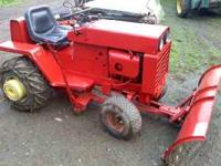 wheel horse d200 with a 54 inch plow, works great for