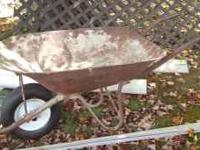 Metal Wheelbarrow. New tire. Handles and frame in good