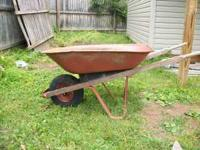 Wheelbarrow (red) flat tire. plz call  Location: