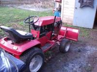 New paint ,tiller, mowing deck, snow plow has two