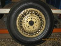 1966-69 Toronado or 1967-69 Eldorado rims w/ tires.