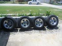"""4 Cooper Discover H/T P215/75R15 tires mounted on 15"""""""