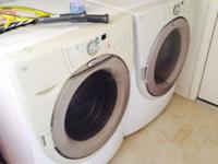 This is a Whirlpool gas front load washer and clothes
