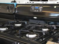 THE WHIRLPOOL STOVE IS IN GOOD CONDITION ITS JET BLACK