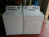 Matching Whirlpool washer and clothes dryer for sale.