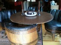 Table and 4 leather chirs all from whiskey barrels. In