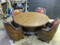 For sale is a table and set of four chairs. The four