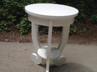 This is a lovely round accent table. It has fresh paint