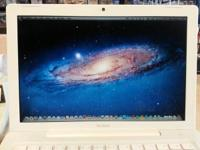 Perfectly functioning 13 Inch White Macbook in