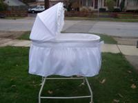 This white bassinet made by Delta is nice for either a