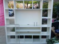 White shelves or shelving unit approximately 6' by 6'