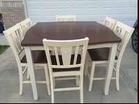 Gorgeous counter height white and cherry dining table