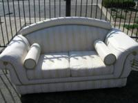 We are selling 2 white & gold couches/loveseats which