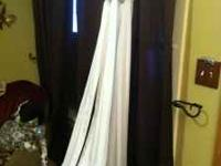 Size 8 white formal gown has a very pretty sparkle all