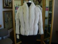 This is a beautiful, luxurious white fox fur jacket,