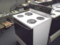 This is a USED GE coil top electric stove white in