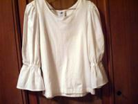 The blouse is white cotton and is washable. The bodice