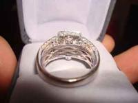I'm selling a beautiful white gold engagement ring.
