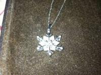 snow flake diamond pendant with white gold backing and