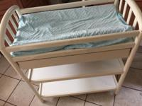 Beautiful white Pali changing table with one drawer.