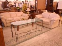 Available for sale we have a 2 item white leather sofa