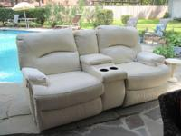 White Leather Love Seat with electric motion,in great