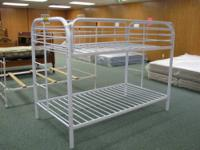 White metal, twin over twin bunk bed. Brand New.