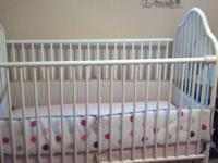 White metal baby crib complete. Comes with sheets