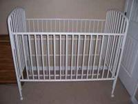 White metal baby bed for sale--child in toddler bed