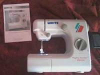 I have a cute little White Mighty Mender Sewing Machine