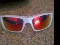 Brand new White oakley sunglasses with red/orange lens.