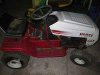 white outdoor lawn tractor use for parts call caro 1-