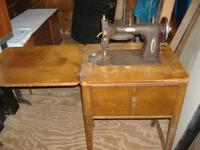 OLD WHITE SEWING MACHINE IN ORIGINAL CABINET.MOTOR RUNS