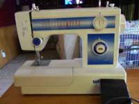5 year old White table top sewing machine..multiple