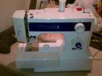 White Sewing Machine. Needs a new lightbulb but works