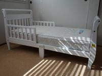 White toddler bed for sale.  $50  - Solid wood - safety