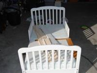 Adorable white wooden toddler bed. Bed comes with