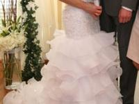 Beautiful white wedding dress with short train in
