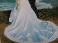 White wedding dress Long sleeved. With lace, stain.