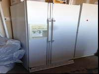 white whirlpool side-by-side refrigerator with water