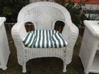 White wicker chair.Big and roomy. Perfect for sun room,
